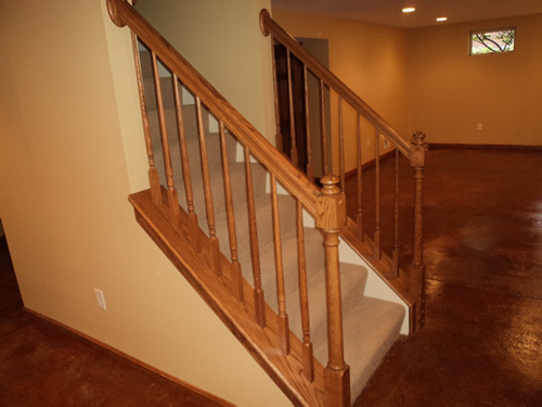 Custom banister in finished lower level.